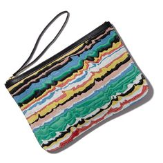 #PierreHardy Perfectly sized to fit inside a work tote during the day, then brought out come nighttime, this brightly colored pouch is the perfect statement piece.