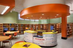 Fun circulation desk and great color palette @ Library Design Showcase 2012: Super Schools | American Libraries Magazine