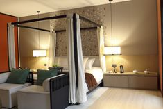 Contemporary master bedroom and four post canopy bed