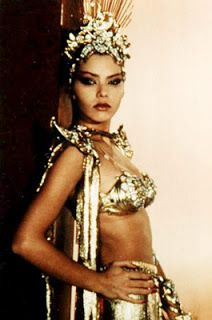 Princess Aura in Flash Gordon ( 1980) This is up there with Princess Leia's gold bikini, but because she's a baddie she gets pagoda shoulders. It's just so King and I. I love it !