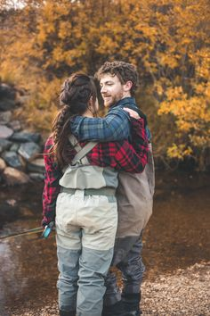 Alyssa +Ben Photo By Ashley Hoyle Photo Fall Fly Fishing Engagement Session in Colorado
