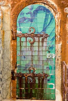 Collioure Lighthouse Door Perpignan  Harbour,  Pyrénées-Orientales, France    Sometimes a door just has to be photographed.  Look at how the rusting metal has patterned the door <3
