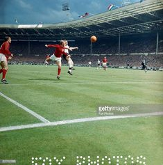 England 4 West Germany 2 in 1966 at Wembley. Bobby Moore shadows Uwe Seeler in the World Cup Final. 1966 World Cup Final, Stock Pictures, Stock Photos, Bobby Moore, Wembley Stadium, Fifa World Cup, Finals, Competition, Germany
