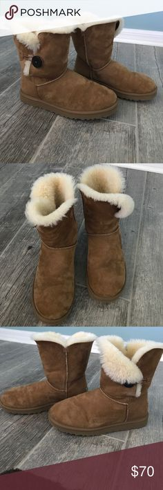 "Uggs Bailey Button Bailey Button in chestnut. Light wear. Wear it buttoned up or undone and cuffed to expose the plush interior. No box.   Twinface and suede Wood button closure Sheepskin insole Treadlite by UGG™ outsole 7.5"" shaft height UGG Shoes Winter & Rain Boots"