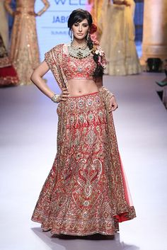 Nargis Fakhri for Suneet Varma at Lakme Fashion Week Summer/Spring 2015. To view, log on to: http://www.vogue.in/content/bollywood-showstoppers-lakme-fashion-week-summer-resort-2015#2