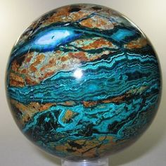 Chrysocolla. Looks almost like it could be one of the planets.