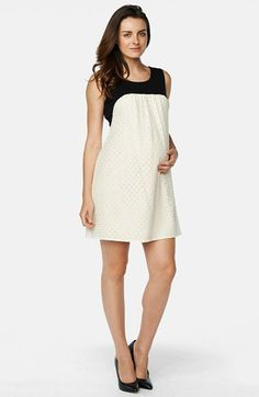 Free shipping and returns on Maternal America Sleeveless Maternity/Nursing Dress at Nordstrom.com. A contrast yoke looks sleek and modern on a stretch-knit babydoll dress styled with a flattering draped front of cotton-silk eyelet. A hidden split front provides discreet access for easy nursing after baby arrives.