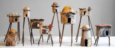 AN ARTISTIC rustic version of the architecture clay project. Great idea to mount them on stilts for display.   Marieken Bischoff