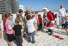 Santa Drop at the Flora Bama - Be there when Santa parachutes onto the beach!