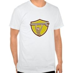 Mechanic Lifting Spanner Wrench Crest Cartoon T-shirt. Illustration of a mechanic wearing hat and overalls looking to the side lifting giant spanner wrench over head viewed from front set inside circle on isolated background done in cartoon style. #Illustration #MechanicLiftingSpanner