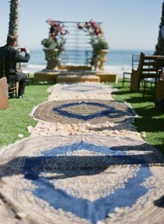 Skip the rose petals and try using a rug to style your aisle! See More Ideas: http://thebridaldetective.com/12-amazing-ways-to-style-your-wedding-with-rugs/