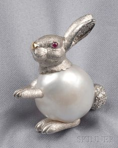 White Gold Baroque Pearl and Diamond Rabbit Brooch E. Wolfe & Co. London with cabochon ruby eyes and diamond melee ears and cotton tail lg. English hallmarks and maker's mark. Pearl Jewelry, Antique Jewelry, Vintage Jewelry, Fine Jewelry, Jewellery, Jewelry Accessories, Jewelry Design, Holiday Jewelry, Pearl Brooch