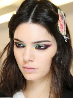 Colour chameleon: Kendall's bright brown peepers were decorated with artistically-applied multi-coloured eyeliner