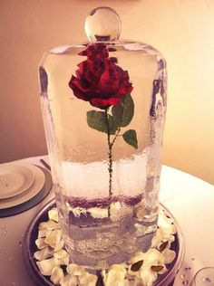 This is actually pure genius. Freeze the rose so it won't wilt while the ceremony is happening!
