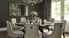 I love this dining room... nothing beats a round table and upholstered chairs for hours of conversation post-dinner.