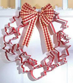 This charming Metal Cookie Cutter Wreath invokes the sweet smells of baking with the shapes of holiday cookies. Classic metal cutters have been transformed into