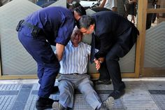 """Heartbreaking Photos Show A Greek Man Crying Over His Country Outside A Bank """"I cannot stand to see my country in this distress,"""""""