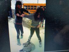 Always poignant school girls battle near bus