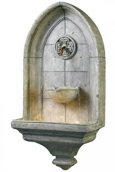 "Canterbury Wall Fountain - lovely  A piece of old England inspires this Gothic styled detail modeled after the famous cathedral in Kent.  Water flows from a Copper spigot while three water streams fall to the basin.  Fountain: 17"" wide x 9 3/4"" ext x 31 7/8"" high  Column: 4 7/16"" wide x 3 5/16"" ext x 3"" high        $284.91"