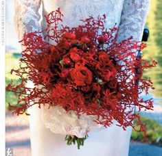 Jessica carried a vibrant deep-red bouquet of scarlet Vanda orchids, ranunculus, and spray roses.