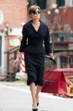 "Angelina Jolie in ""The Tourist"". LOVED the clothes in this movie."