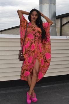Rosemary Kokuhilwa in a tie-dye kaftan via Fashion Junkie