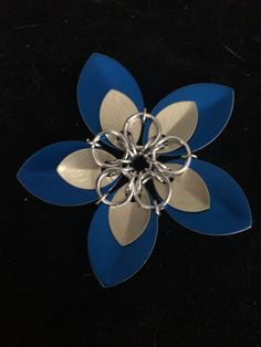 5 petal, double layer scale flower clip. Made from anodized aluminum scales and shiny silver aluminum rings. Measures about 3 inches in diameter. Please specify barrette or alligator clip (as seen in photos) when ordering.  | Shop this product here: http://spreesy.com/PixieMetals/6 | Shop all of our products at http://spreesy.com/PixieMetals    | Pinterest selling powered by Spreesy.com