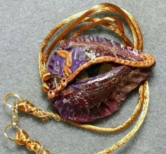 Dragon's Eye on a gold silk cord. I think it's the last one in the group that I wanted to get strung.  Thanks for looking.