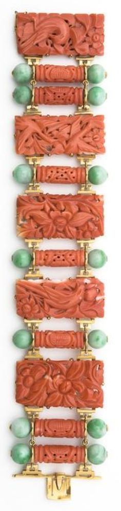 An Art Deco gold, carved coral and jade bracelet by Grivotet and Beleau, Maison Collinet, French, 1925.