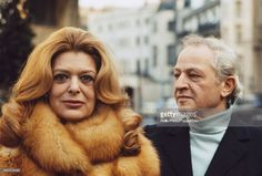 Greek actress Melina Mercouri pictured posed wearing a fur coat with her husband, American film director and actor Jules Dassin in London in March
