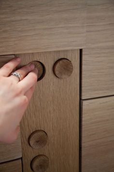 Button mechanism to release drawers ISD 2011-30