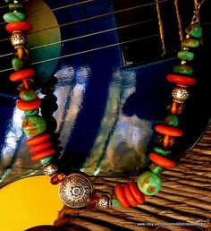 Southwestern Necklace/Handmade Silver Beaded Necklace/Amber/Turquoise and Silver Necklace/Tague Beaded Necklace/Handmade Necklace This beautiful necklace can be worn with a variety of styles. Its strung with wire and is made with older generation BoulderTurquoise nugget, Tague orange disks, Karen Hill Tribe Silver statement disk and beads, beautiful Baltic Amber from Poland, and has a beautiful chain and Hill Tribe Silver clasp. It measures approx 20 around.