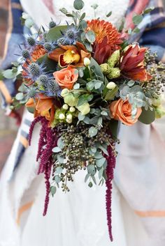 Fall #weddingbouquet idea - orange floral bouquet with greenery and thistle {Elusive Photography}