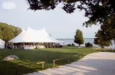 Our style of candid and natural wedding photography was the perfect fit for this beachy wedding at the Cove Cabin at Mount Hope Farm in Bristol,…