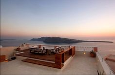 The best view of the sunset on Santorini island. Unobstructed bird's eye views of the Caldera from your Oia Mansion's  Terrace.  Oia village, Santorini island, Greece - selected by www.oiamansion.com
