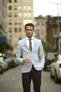Stand out among other stylish civilians in a grey striped blazer jacket and black casual trousers.   Shop this look on Lookastic: https://lookastic.com/men/looks/blazer-dress-shirt-chinos/11408   — White Dress Shirt  — Dark Brown Print Tie  — Grey Vertical Striped Blazer  — Silver Watch  — Black Chinos