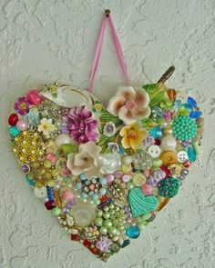 A lovely heart made with pieces of old jewelry, odd buttons and pearls.