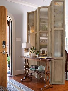 Makeshift entryway ~ such a clever use of a panel to create an entryway when there's none.