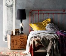 gray walls, red bed frame, yellow pillow. I like it.