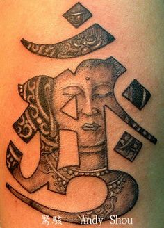 Sanskrit character and a buddha face #Buddha #tattoo