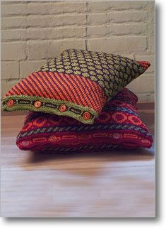 Beautiful multi-color patterned pillows knitted in the round.  Based on traditional Indian textiles, but colors give them a very modern feel.  Lovely color work.  By Sandy Cushman at Interweave.