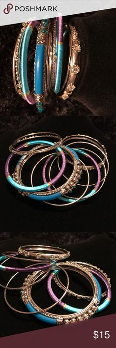NWOT Set of 9 silver, purple,teal bangle bracelets NWOT Set of 9 silver, purple, & teal bangle bracelets made with assorted gems, texture, and threading. Lane Bryant Jewelry Bracelets