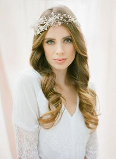 Presented for the natural, bohemian, simplistic, country, and various other types of brides is this genuinely naturalistic bridal chaplet composed of white pearls and flowers branching off of a delicate wreath. An ambiance of graceful effloresce will illuminate any bride who dons this crown