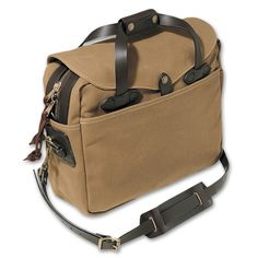 Filson Briefcase bag, waxed canvas, awesome warranty, comes in 3 colors and a couple of similar styles. $260