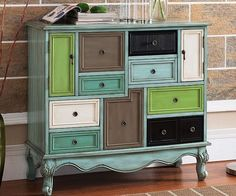 Add a playful touch to any room with this multicolor nice drawer cabinet. The whimsical design features nine differently shaped drawers positioned both vertically and horizontally, ideal for adding a bit of color to your home decor.