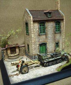 German halftrack towing artillery. Very nice house. 1:35