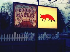 Sign for the Cherry Sprout Produce Market and Red Fox Bar on N Albina.