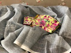Sold Linen silver checks saree with a contrast floral mirror worked blouse For orders/queries Call/ what's app us on Fancy Blouse Designs, Saree Blouse Designs, Cotton Saree Blouse, Linen Blouse, Saree Dress, Teja Sarees, Mirror Work Blouse, Checks Saree, Diana