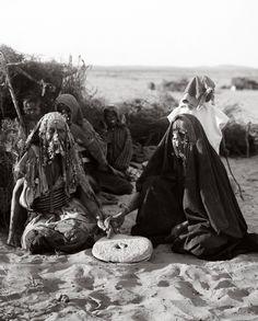 "Palestine   Bedouin woman grinding flour. ""Women of Beersheba (Bi'rus-sebi)"".   ca. 1900-1920. Matson (G. Eric and Edith) Photograph Collection"