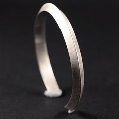 This is a beautifully heavy mens silver bracelet. This sterling silver cuff bracelet/bangle was designed for men but would also suit women. It is made of triangular sterling silver wire, approximately 6.5mm wide and 4mm tall. As with all my silver jewellery, it is made of 100%